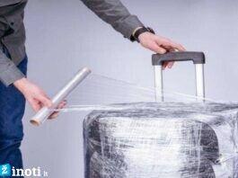 3 priežastys, kodėl neturėtumėte apvynioti lagamino plėvele
