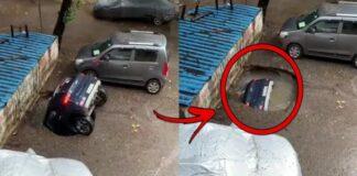Dėl liūčių Indijoje stovėjimo aikštelėje paliktas automobilis prasmego žemėn